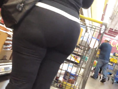 Raunchy bootylicious housewife walks around the supermarket