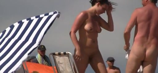 Cutie has some fun in the sun while being naked
