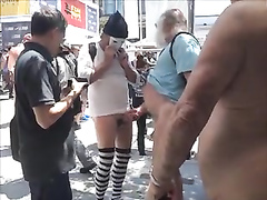 Old daddy strokes his thick dick in a crowd of naked people