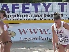 Stunning babes enjoy playing a match of beach volleyball