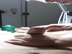 Hairy dude develops a massive boner while being waxed
