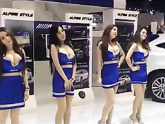Busty babes dancing at the car fair