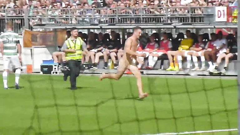 Nude maniac runs around the football field