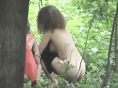 Glamorous dolls taking a pee in the woods