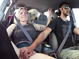 Wheel in one hand and pussy in the other