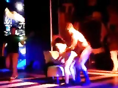 Dancers do a naked performance in the club