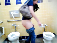 Sweet-looking lass wipes her pussy after taking a long piss
