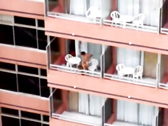Exhibitionist girl gets her hungry pussy plugged hard on the balcony