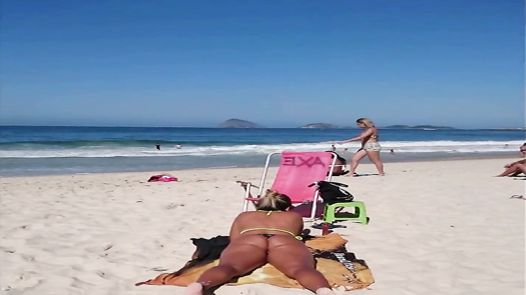 Tanned cutie has her big butt recorded on the beach of Rio de Janeiro