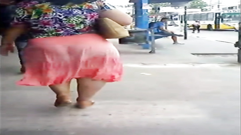 Latina woman with a very large booty walks around the town