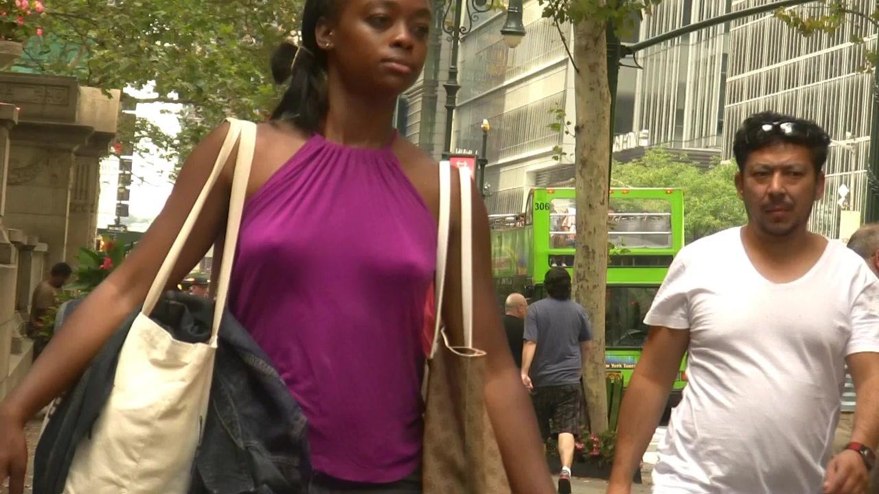 Ebony goddess walks around without any bra on