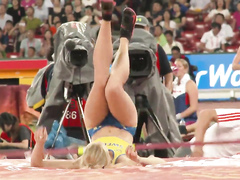 Sexy sportswoman with a big butt does pole vaulting