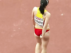 Raven-haired athletic babe competes in long jump