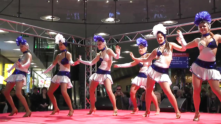 Sexy girls in short skirts dancing for the crowd