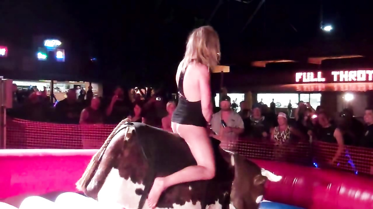 Seductive blonde rides the mechanical bull
