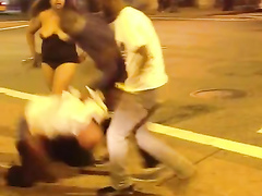 Crazy street fight with some naked boobs
