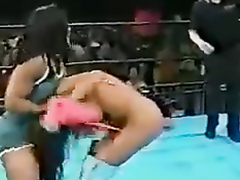 Brunette with visible boobs in the wrestling ring
