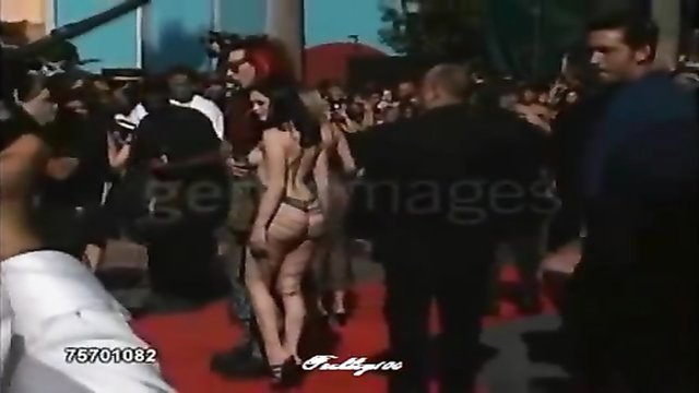 Famous rock star appears in public with a lady that is almost naked