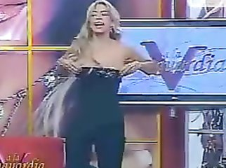 Busty TV host barely keeps her tits in her shirt