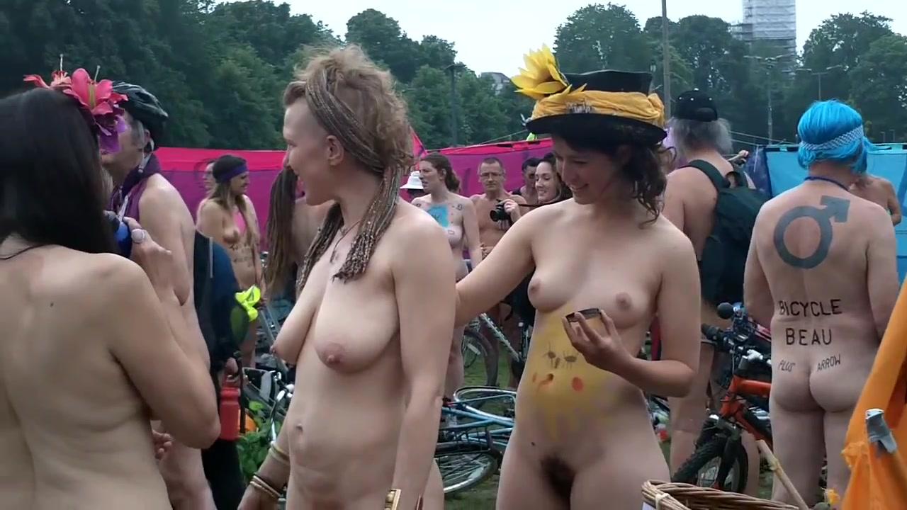Ambitious men and women riding their bikes naked