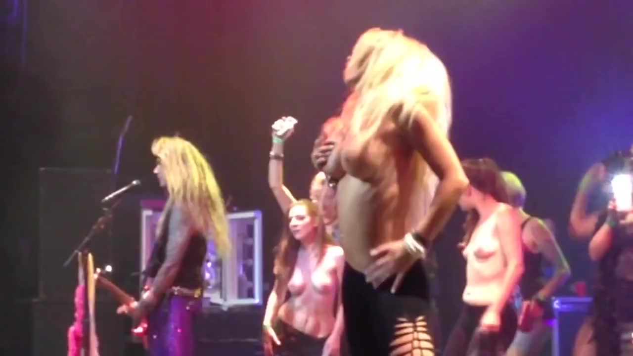 Stunning babes show off her big tits at a concert
