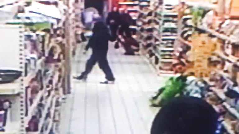 Impudent brunette urinates in the middle of the supermarket floor