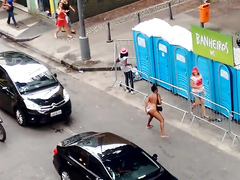 Shameless Brazilian woman urinates in the middle of the road