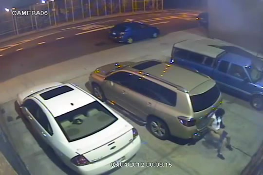 Security camera catches a girl peeing behind a car