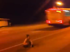 Graceful brunette takes a leak on the highway