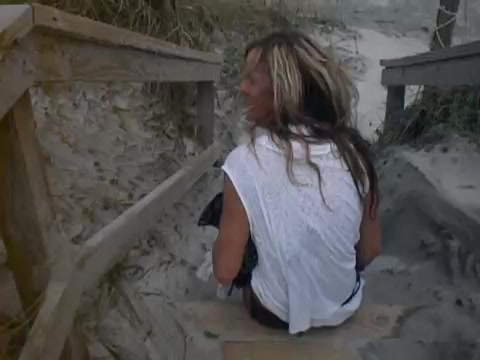 Lustful blonde soaks the sandy stairs