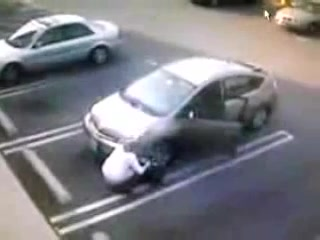 Desperate amateur took a pee next to her car