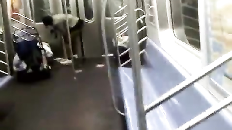 Nasty homeless woman takes a piss inside the train