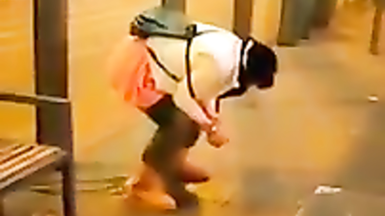 Wicked homeless woman urinates at the crowded place