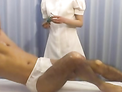 Appealing masseuse milks the penis with ease
