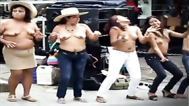 Busty Latina women dancing topless on the street