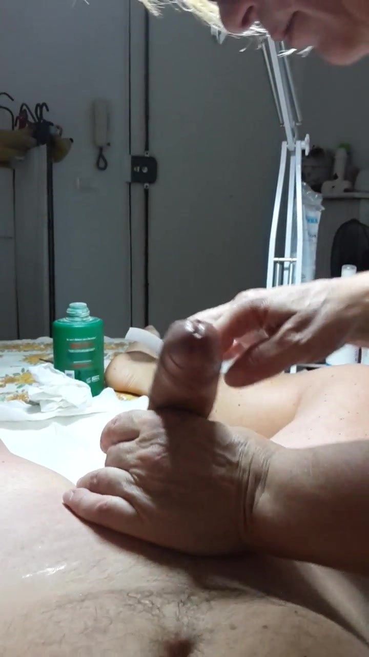 Older Vietnamese masseuse takes care of my hairy penis and balls