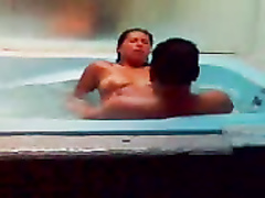 Mexican prostitute rides my brother's dick in the jacuzzi