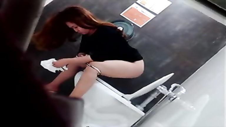 Intriguing Asian brunette filmed while taking a pee