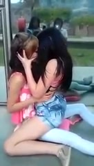 Two stunning lesbians make out with each other in public