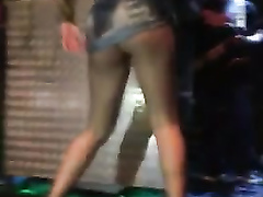 Chick with the sexiest legs dances for the crowd