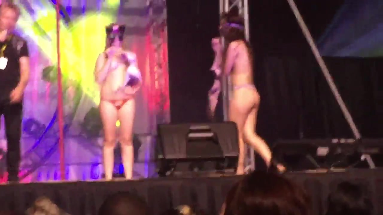 Foxy bombshells dance and strip sensually on the stage
