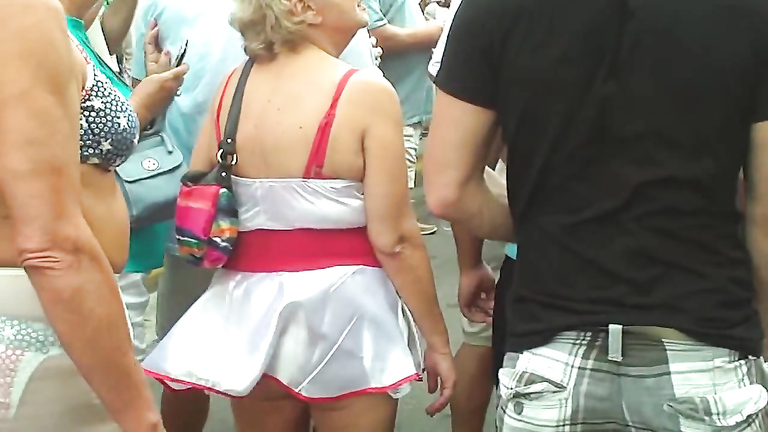 Following the hot old lady and her sexy skirt
