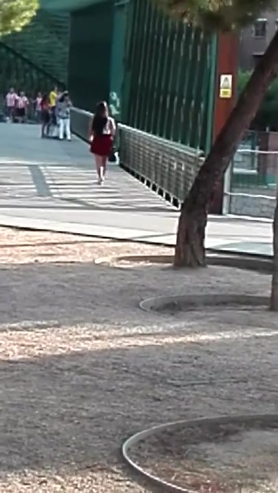 Red skirt goes up and uncovers her sexy bottom
