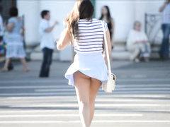 Tasty brunette lady has her round butt revealed by the wind