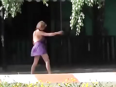 Drunk village chick enjoys doing cartwheels in a short summer dress