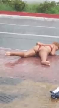 Alluring madam goes completely nuts in the rain!