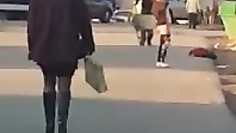Crazy maid exposes her ass in the middle of the street