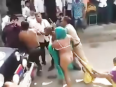 Street fight with a naked female ass