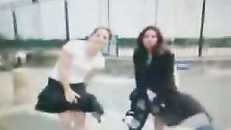 Two babes having problems with the windy weather