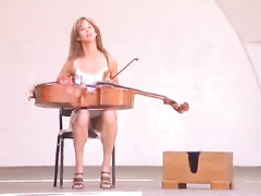 Sexy musician reveals her panties while tuning her instrument